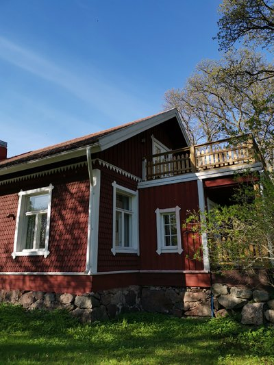The charming red shingle-covered house from the 19th century